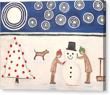 Making A Snowman At Christmas Canvas Print by Patrick J Murphy