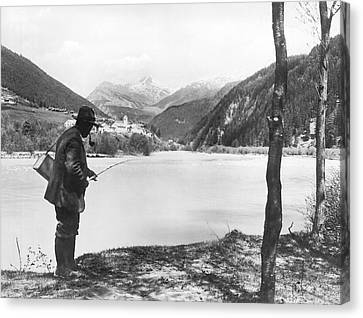 Man Fishing In Switzerland Canvas Print by Underwood Archives