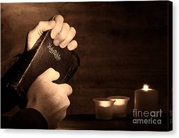 Man Hands And Bible Canvas Print by Olivier Le Queinec