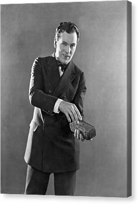 Man Holding A Brick Canvas Print by Underwood Archives