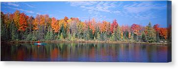 Man In Canoe Nr Antigo Wi Usa Canvas Print by Panoramic Images