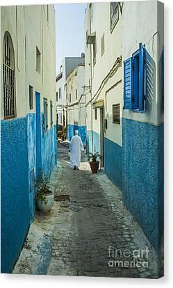 Man In White Djellaba Walking In Medina Of Rabat Canvas Print by Patricia Hofmeester
