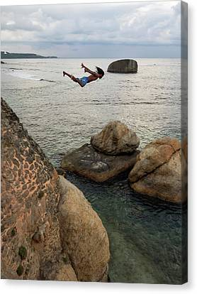 Man Jumping Off Flag Rock Bastion Canvas Print by Panoramic Images