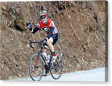 Man Riding Bike In A Race Canvas Print by Susan Leggett