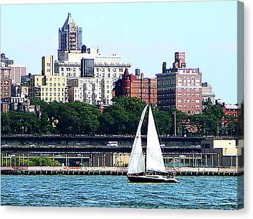Manhattan - Sailboat Against Manhatten Skyline Canvas Print by Susan Savad