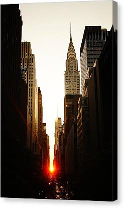 Manhattanhenge Sunset And The Chrysler Building  Canvas Print by Vivienne Gucwa