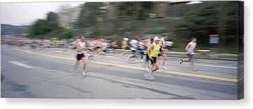 Marathon Runners On A Road, Boston Canvas Print by Panoramic Images