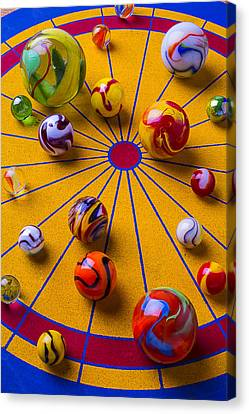 Marbles On Game Board Canvas Print by Garry Gay