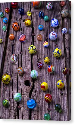 Marbles On Wood Canvas Print by Garry Gay