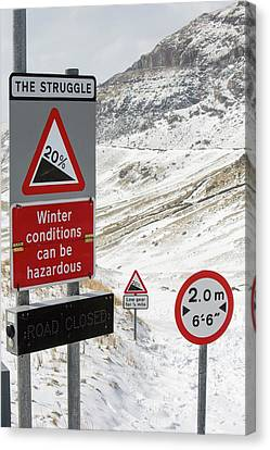 Massive Snow Drifts Blocking A Road Canvas Print by Ashley Cooper