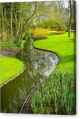 Meandering Stream Through Keukenhof Gardens Near Lisse Netherlands Canvas Print by Robert Ford