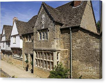 Medieval Houses In Lacock Village Canvas Print by Patricia Hofmeester