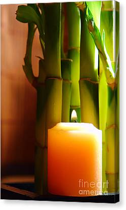 Meditation Candle And Bamboo Canvas Print by Olivier Le Queinec