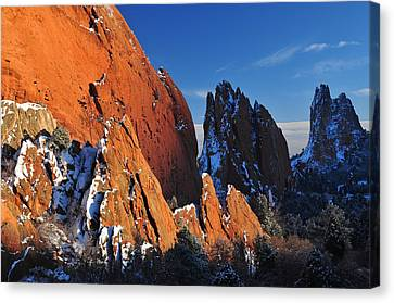 Megaliths With Snow At Sunset Canvas Print by John Hoffman