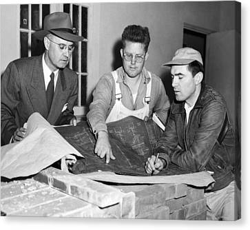 Men Looking At Blueprints Canvas Print by Underwood Archives