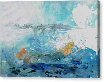 Mermaid Swimming With Dolphins Canvas Print by Nancy Gorr