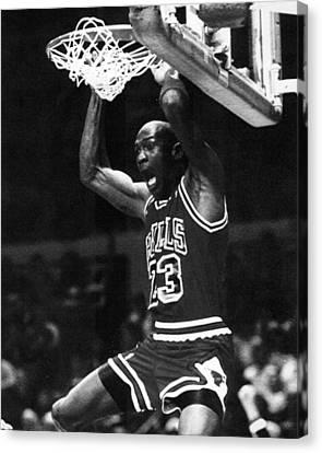 Michael Jordan Dunks Canvas Print by Retro Images Archive