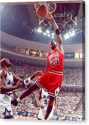 Michael Jordan Dunks With Left Hand Canvas Print by Retro Images Archive