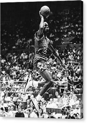 Michael Jordan Gliding Canvas Print by Retro Images Archive