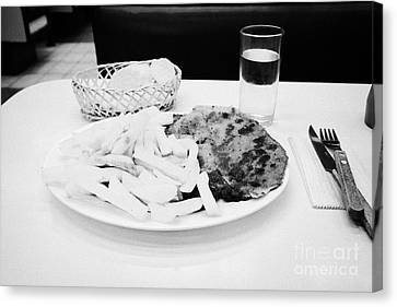 milanesa steak with french fries in a cafe Santiago Chile Canvas Print by Joe Fox