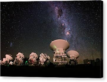 Milky Way Over Alma Telescopes Canvas Print by Babak Tafreshi