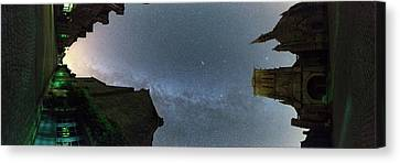 Milky Way Over Town Canvas Print by Laurent Laveder