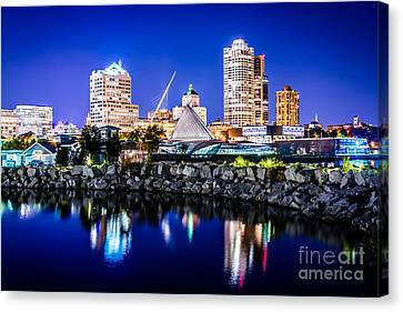 Milwaukee Skyline At Night Photo In Blue Canvas Print by Paul Velgos