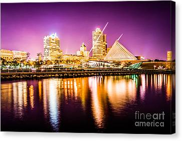Milwaukee Skyline At Night Picture In Purple Canvas Print by Paul Velgos
