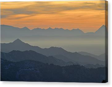 Mists In The Mountains At Sunset Canvas Print by Guido Montanes Castillo