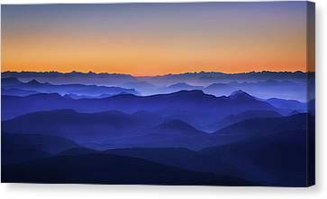 Misty Mountains Canvas Print by David Bouscarle