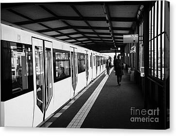 modern yellow u-bahn train sitting at station platform Berlin Germany Canvas Print by Joe Fox