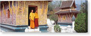 Monks Wat Xien Thong Luang Prabang Laos Canvas Print by Panoramic Images