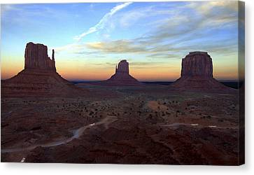 Monument Valley Just After Sunset Canvas Print by Mike McGlothlen