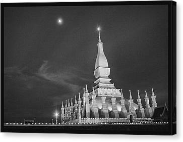Moon Over Vientiane Canvas Print by David Longstreath