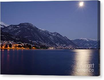 Moonlight Over A Lake Canvas Print by Mats Silvan