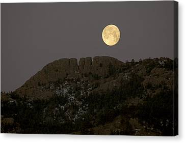 Moonset Over Horsetooth Canvas Print by Rich Ernst