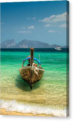 Moored Longboat Canvas Print by Adrian Evans