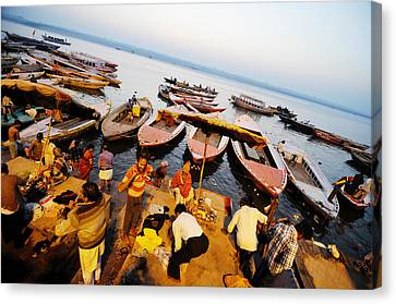 Morning Bath At Ganga Canvas Print by Money Sharma