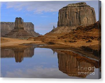 Morning Reflections In Monument Valley Canvas Print by Sandra Bronstein
