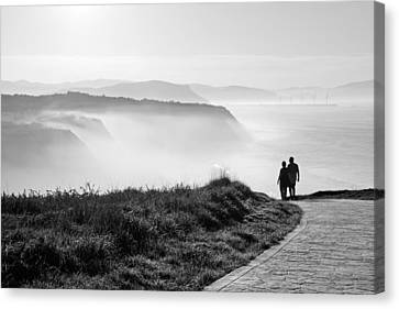Morning Walk With Sea Mist Canvas Print by Mikel Martinez de Osaba