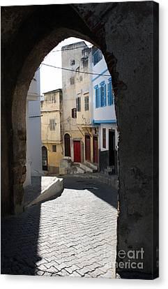 Morocco Door Light Canvas Print by Joe Fantauzzi