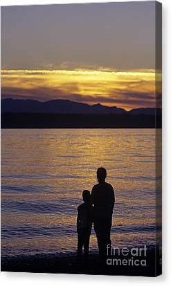 Mother And Daughter Holding Each Other Along Edmonds Beach At Su Canvas Print by Jim Corwin
