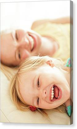 Mother And Her Daughter Laughing Canvas Print by Ian Hooton