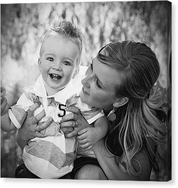 Mother And Son Laughing Together Canvas Print by Daniel Sicolo