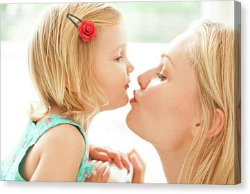 Mother Kissing Daughter Canvas Print by Ian Hooton