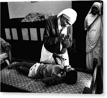 Mother Teresa Helping Boy Canvas Print by Retro Images Archive