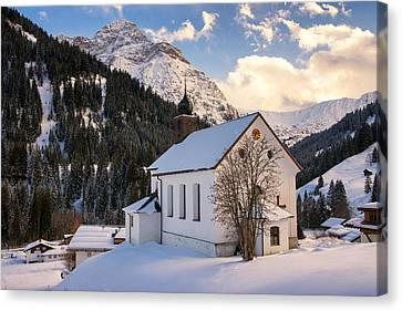 Mountain Church In The Alps - Baad Kleinwalsertal Austria In Winter Canvas Print by Matthias Hauser