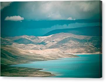 Mountain Lake In Tibet Peiku-tso Canvas Print by Raimond Klavins