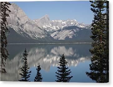 Mountain Lake Reflecting Mountain Range Canvas Print by Michael Interisano
