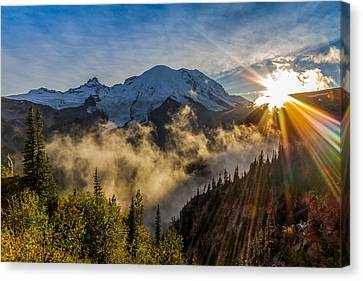 Mt Rainier Sunburst Canvas Print by Ken Stanback